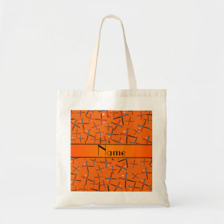 Personalized name orange field hockey pattern tote bag