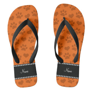 Personalized name orange hearts and paw prints flip flops