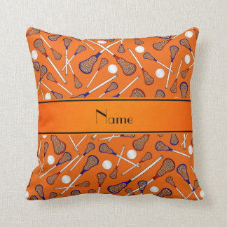 Personalized name orange lacrosse pattern throw pillow