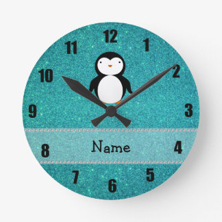 Personalized name penguin turquoise glitter round clock