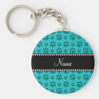 Personalized name turquoise dog paw prints key ring