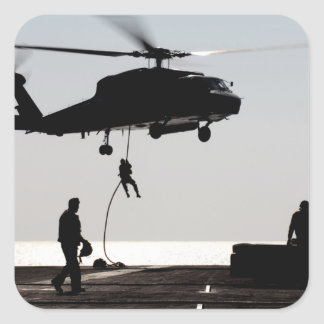 Personnel fast-rope out of an SH-60F Square Sticker