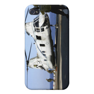 Personnel walk into the rear of a CH-46E iPhone 4 Cover