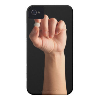 Persons hand holding a white pill between the iPhone 4 Case-Mate cases