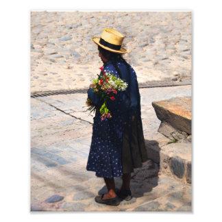 Peruvian Woman Holding Flowers Photograph