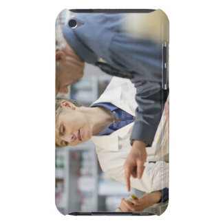 Pharmacist helping customer with medicine iPod touch covers