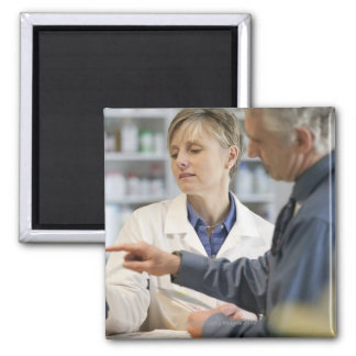 Pharmacist helping customer with medicine square magnet