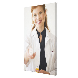 Pharmacist holding bottle of prescription canvas print