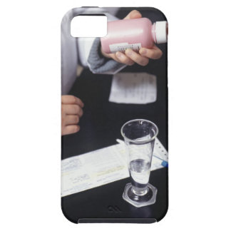 Pharmacist holding medicine bottle, close-up, iPhone 5 cover