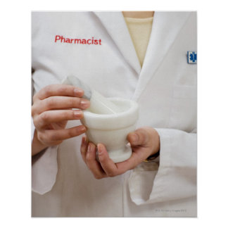 Pharmacist holding mortar and pestle poster