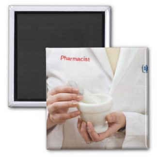 Pharmacist holding mortar and pestle square magnet