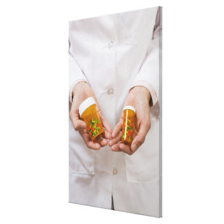 Pharmacist holding pill bottles canvas print
