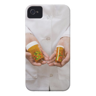 Pharmacist holding pill bottles iPhone 4 covers