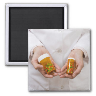 Pharmacist holding pill bottles square magnet