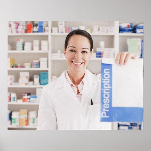 Pharmacist holding prescription in drug store posters