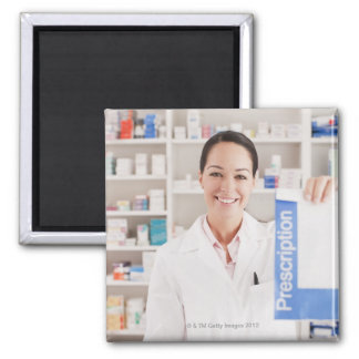 Pharmacist holding prescription in drug store square magnet