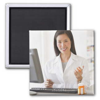 Pharmacist holding prescription medication square magnet