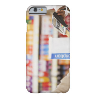 Pharmacist holding security device for customer barely there iPhone 6 case