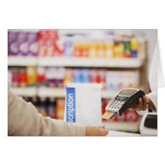 Pharmacist holding security device for customer card