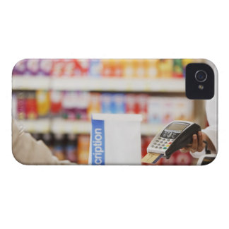 Pharmacist holding security device for customer iPhone 4 case