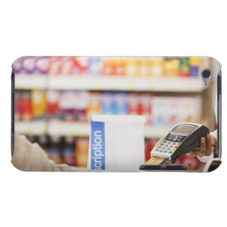 Pharmacist holding security device for customer iPod Case-Mate case
