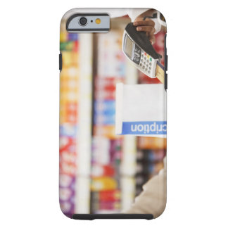 Pharmacist holding security device for customer tough iPhone 6 case