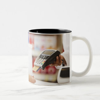 Pharmacist holding security device for customer Two-Tone coffee mug