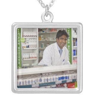 Pharmacist in a pharmacy pendants