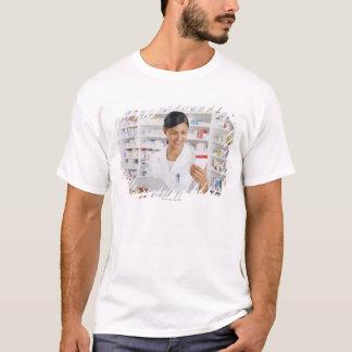 Pharmacist in drug store holding clipboard T-Shirt