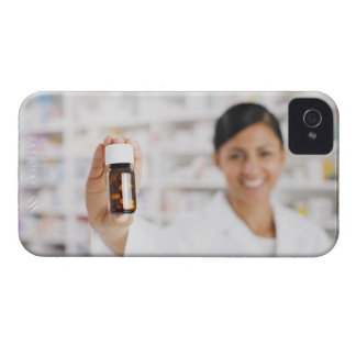 Pharmacist in drug store holding out pill bottle iPhone 4 covers