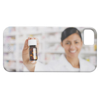 Pharmacist in drug store holding out pill bottle iPhone 5 cover