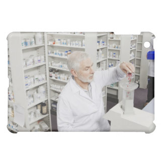 Pharmacist pouring pills into counting machine cover for the iPad mini