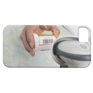 Pharmacist scanning pill bottle with a barcode case for the iPhone 5
