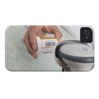 Pharmacist scanning pill bottle with a barcode iPhone 4 covers