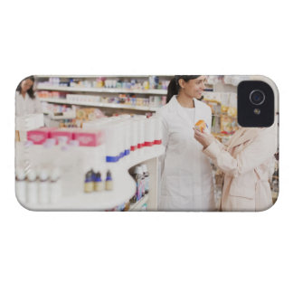 Pharmacist talking to customer in drug store Case-Mate iPhone 4 cases