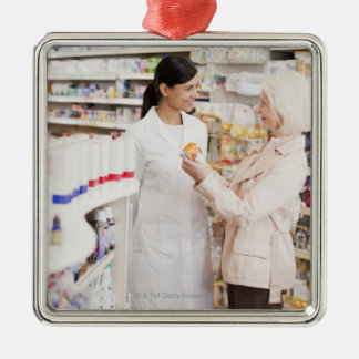 Pharmacist talking to customer in drug store christmas ornament