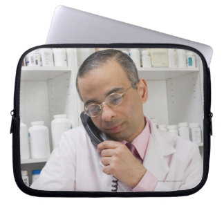 Pharmacist using a phone laptop sleeve