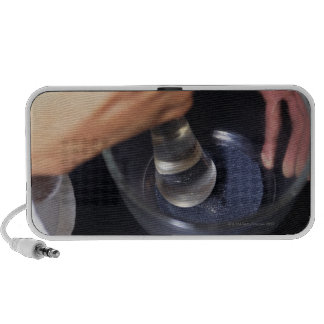 Pharmacist using mortar and pestle on table travelling speaker