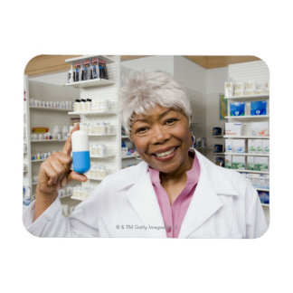 Pharmacist with giant pill rectangular photo magnet