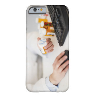 Pharmacist with pill bottles at computer barely there iPhone 6 case