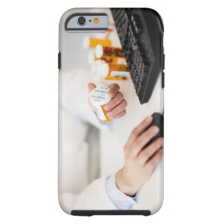 Pharmacist with pill bottles at computer tough iPhone 6 case