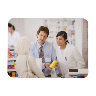 Pharmacists answering questions for customer in magnet