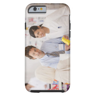 Pharmacists answering questions for customer in tough iPhone 6 case