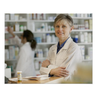 Pharmacists at counter of retail pharmacy poster