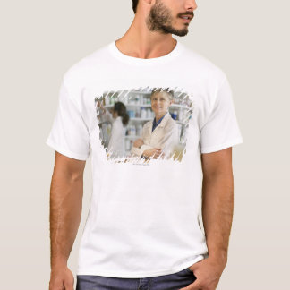 Pharmacists at counter of retail pharmacy T-Shirt
