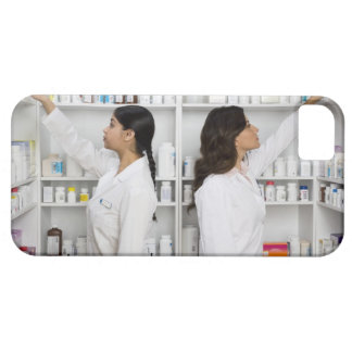 Pharmacists reaching for medication on shelves iPhone 5 case