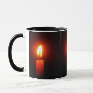 PHOTO OF 3 LIT RED CANDLES ON COFFEE MUG. MUG