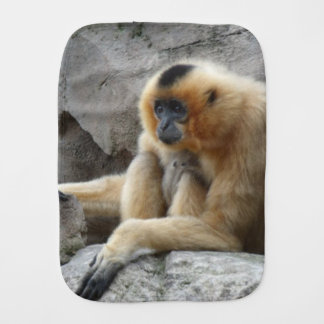 Photo of Orange and Black Gibbon Relaxing on Cliff Baby Burp Cloth