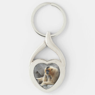 Photo of Orange and Black Gibbon Relaxing on Cliff Silver-Colored Twisted Heart Key Ring