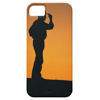 Photo, silhouette of a cowboy with his hand on case for the iPhone 5